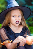 Portrait of cute little girl wearing witch costume Stock Image