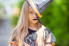 Portrait of cute little girl wearing witch costume Stock Images