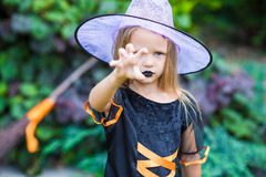 Portrait of cute little girl wearing witch costume Stock Photos
