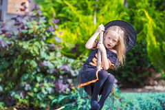 Portrait of cute little girl wearing witch costume Royalty Free Stock Photography