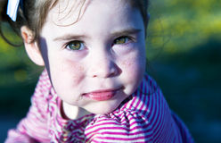 Portrait cute little girlie. Beautiful eyes of cute girlie are in the bright sunny light royalty free stock images