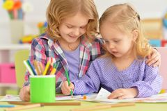 Little girls drawing. Portrait of a cute little girls drawing together Stock Image