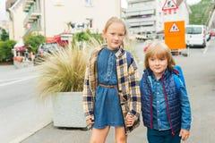 Portrait of cute little kids. Cute kids with backpacks walking to school Royalty Free Stock Image