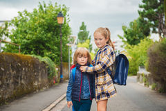 Portrait of cute little kids. Cute kids with backpacks walking to school Stock Photos