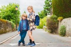 Portrait of cute little kids. Cute kids with backpacks walking to school Stock Photo