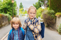 Portrait of cute little kids. Cute kids with backpacks walking to school Royalty Free Stock Photos