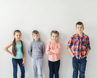 Portrait of cute little kids in wear clothes looking at camera and smiling Stock Images