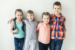 Portrait of cute little kids in wear clothes looking at camera and smiling royalty free stock image