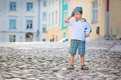 Portrait of a cute little old boy outdoors in city Stock Images