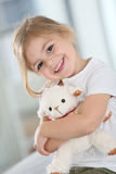 Portrait of cute little smiling girl with teddybear Royalty Free Stock Photos
