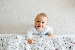 Portrait of cute little toddler child shot from above, baby boy stock photo