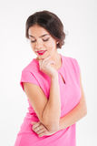 Portrait of cute lovely smiling young woman on pink top Royalty Free Stock Images