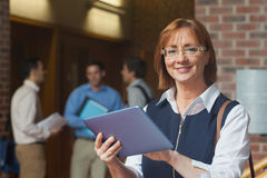 Portrait of cute mature student holding her tablet Royalty Free Stock Photo