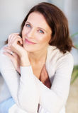 Portrait of a cute mature woman smiling Stock Photography