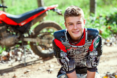 Portrait of cute motocross rider outdoors. Stock Photos