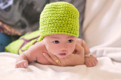 Portrait of cute newborn baby girl on the bed Stock Images