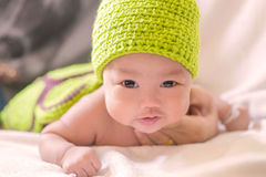 Portrait of cute newborn baby girl on the bed Stock Image