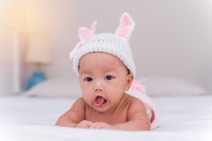 Portrait of cute newborn baby girl on the bed Stock Photo