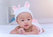 Portrait of cute newborn baby girl on the bed Royalty Free Stock Images