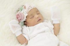 Portrait of cute newborn baby sleeping on white blanket royalty free stock image