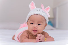 Portrait of cute newborn baby smile on the bed Stock Images