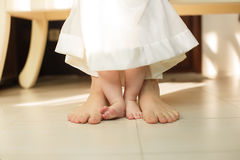 Portrait of Cute newborn foot with family members standing on the floor Stock Photos