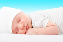 Portrait of a cute newborn sleeping baby. On a blue background royalty free stock photo