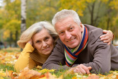 Portrait of a cute older couple lying royalty free stock photos