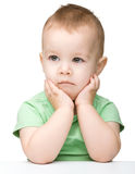 Portrait of a cute and pensive little boy Stock Image