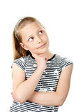 Portrait of a cute pensive little girl on white Stock Image