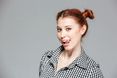 Portrait of cute playful young woman showing tongue Royalty Free Stock Image