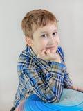 Portrait of cute redhead сaucasian boy, elementary school student  on grey background. Portrait of cute Caucasian boy, elementary school student  on grey Stock Photos