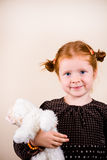Portrait of cute redhead girl. Portrait of redhead girl over background with her toy Stock Photography