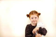 Portrait of cute redhead girl. Portrait of redhead girl over background with her favorite toy Stock Photography