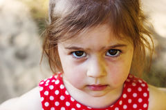 Portrait of cute sad little girl looking at camera at summer day. Portrait of cute sad little girl looking at camera Royalty Free Stock Photo