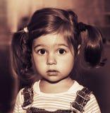 Portrait of cute sad little girl thinking. Toned. Portrait of sad little girl thinking. Toned Stock Photo