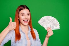 Portrait cute satisfied lady cheerful content hold hand laugh advise ads alright deal decision decide recommend lottery. Stylish jeans outfit long straight hair royalty free stock photo