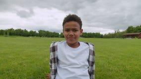 Portrait of cute school age african american boy outdoors