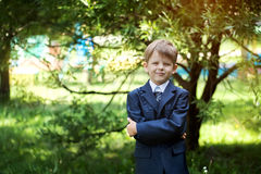 Portrait of cute school boy with backpack outdoors Royalty Free Stock Image