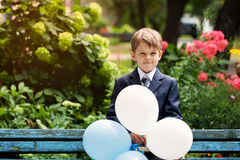 Portrait of cute school boy in the park, sunny day Royalty Free Stock Image