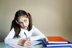 Portrait of a cute school girl at her desk Royalty Free Stock Image