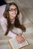 Portrait of cute school girl reading book Stock Images