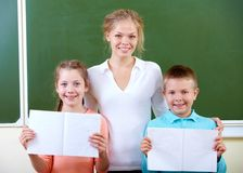 Teacher and schoolkids Stock Photography