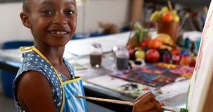 Portrait of cute schoolgirl painting on canvas 4k stock video