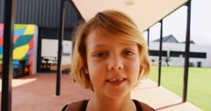 Portrait of cute schoolgirl walking with backpack 4k stock video