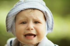 Portrait of cute screaming boy Stock Photo