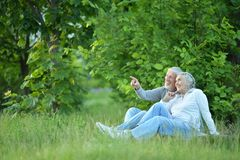Portrait of cute senior couple in the park royalty free stock images