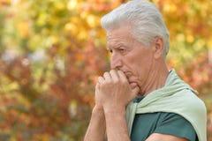 Portrait of a senior man posing outdoors stock photos