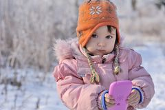 Portrait of beautiful little girl in winter forest royalty free stock images