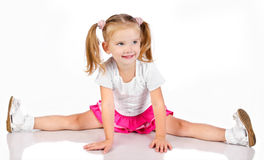 Portrait of cute sitting smiling little girl Stock Photo